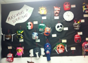 Grade 9 Identity Project - Masks with characteristics written in Spanish.
